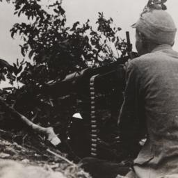 Seated Man At Gun