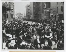 Crowds waiting to enter morgue to identify bodies of Triangle Shirtwaist fire in 1911; This scene is the pier at foot of 26th Street
