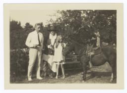 Frances Perkins, Paul Wilson, and Susanna Perkins Wilson with a horse