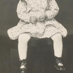 [Child in a Dress Sitting o...