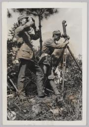Chinese Men Surveying With Periscope