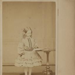 Girl Standing at a Round Table