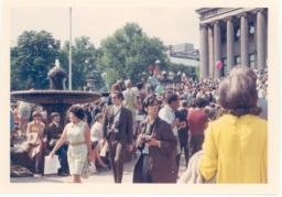 1968 counter commencement with woman in yellow dress