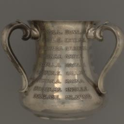 Silver cup presented to Mac...