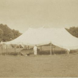 Big White Tent in Field