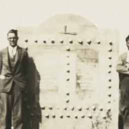 Two Men Standing next to a ...