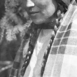 Close-Up of Woman with Brai...