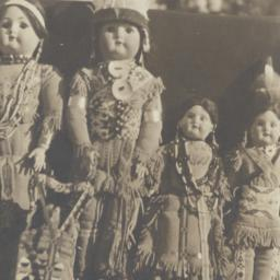 Row of Dolls in Native Amer...