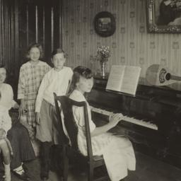 Family Around a Piano