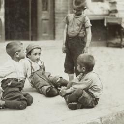 Boys Playing on Sidewalk