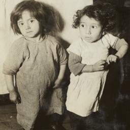 Two Little Girls near Bed