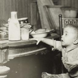 Child Reaching for Milk