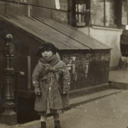 Girl on Sidewalk Wearing Ha...