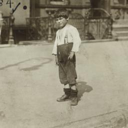 Boy Standing on Sidewalk