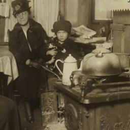 Child with Cat and Two Women