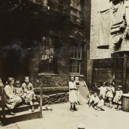 Children Between Buildings