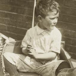 Boy Sitting in Cardboard Box