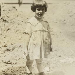Girl near Mound of Dirt