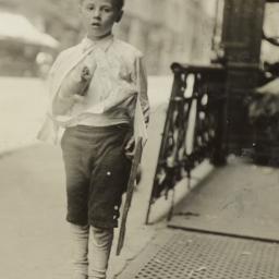 Boy in Socks on Curb