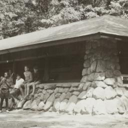 Boys Outside Cabin near Woods