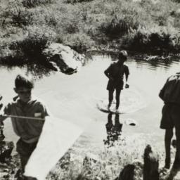 Boys around Body of Water