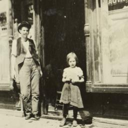 Man and Girl in Front of Shop