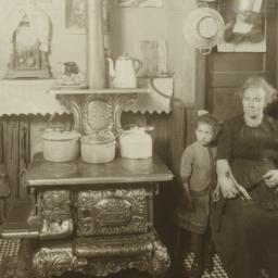 Woman with Girl near Stove