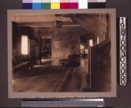 Entry hall\, view past the staircase toward den (on right) and dining room.
