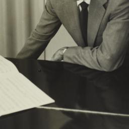 Ulysses Kay leaning on pian...