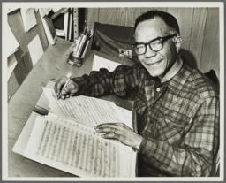 Photograph of Ulysses Kay with manuscripts